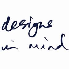 Designs in Mind written in black handwriting on white background