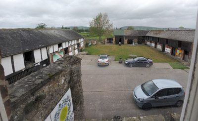 a photo of farm buildings and countryside. This is what Mid Wales Arts Centre is based!