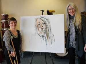 Tanya Raabe-Webber with Dame Evelyn Glennie in the National Portrait Gallery as part of her larger project called Portraits Untold